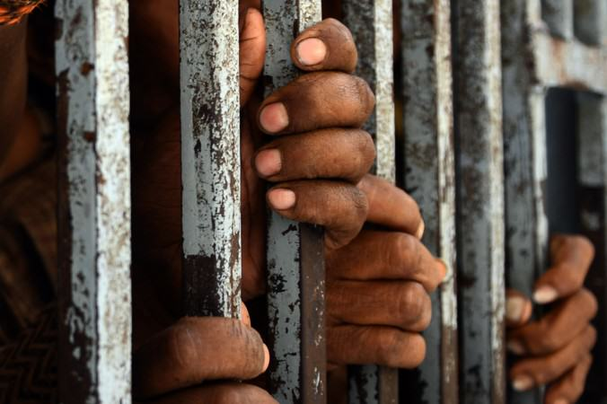 Someones Just Been Sentenced To Three Years In Prison For Sharing This Photo UNILAD Prison black hands on bars10681