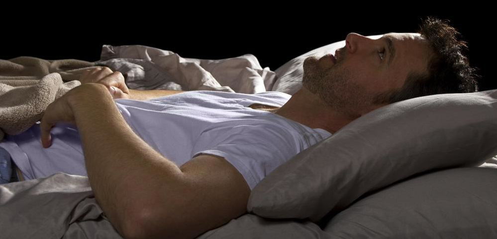 The Top Nine Most Common Dreams And What They Mean UNILAD UNILAD man in white shirt lying awake in bed3917929306