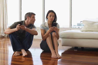 Couple with Cellular Phones in Condominium