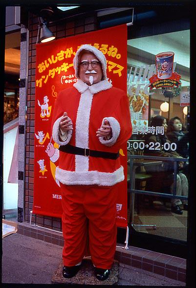 The Traditional Japanese Christmas Dinner Is KFC, Because Why Not? Colonel dressed as Santa