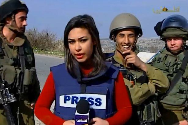 Palestinian Journalist Does Brilliant Job While Being Trolled By Israeli Soldiers IDF soldiers trolling Palestinian reporter 1