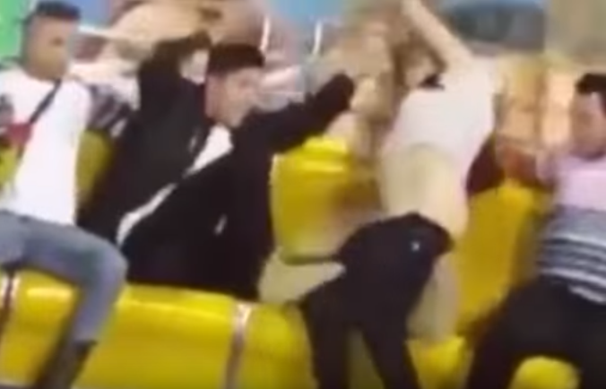 Desperate Lad Tries To Cover Girlfriend After She Loses Trousers On Fairground Ride Screen Shot 2015 12 31 at 16.01.09 1