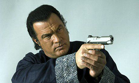 Steven Seagal aiming gun