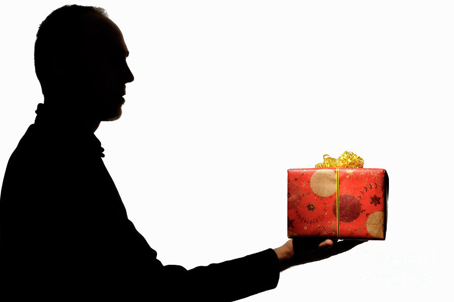 Guys Generous Christmas Act Doesnt Get The Response He Expected silhouette of man holding gift sami sarkis