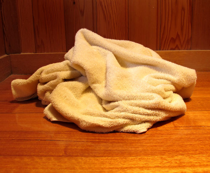 Theres A Really Disgusting Reason Experts Are Recommending Washing Bath Towels Regularly towel on the bathroom floor for web