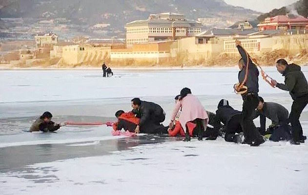 Incredible Moment Crowd Rescue Dying Man Using A Scarf 306A63E600000578 3409753 image a 6 1453369139204