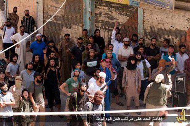 ISIS Militant Publicly Executes Own Mother For Ridiculous Reason ISIS execute a gay man in DirZour by throwing him from High building