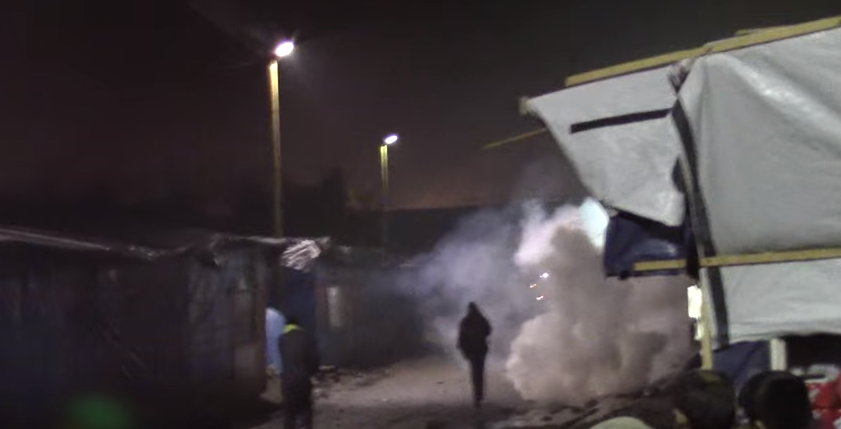 Banksy Reveals New Artwork Criticising Use Of Teargas In Calais Refugee Camp Screen Shot 2016 01 25 at 10.53.49
