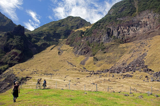 Tristan Da Cunha Island, settlement capital of Edinburgh. Walkers exploring the foothills of the Queen Mary Volcano