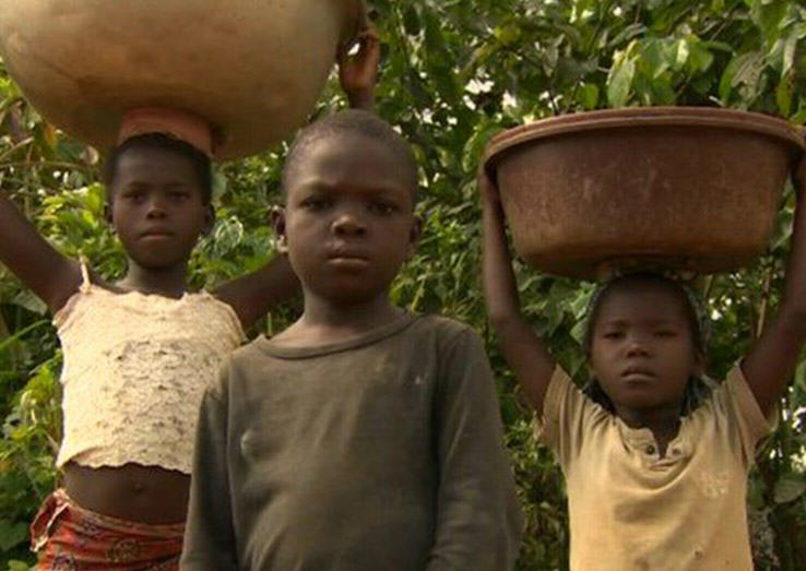 the issue of child trafficking and the use of child slavery on cocoa plantations