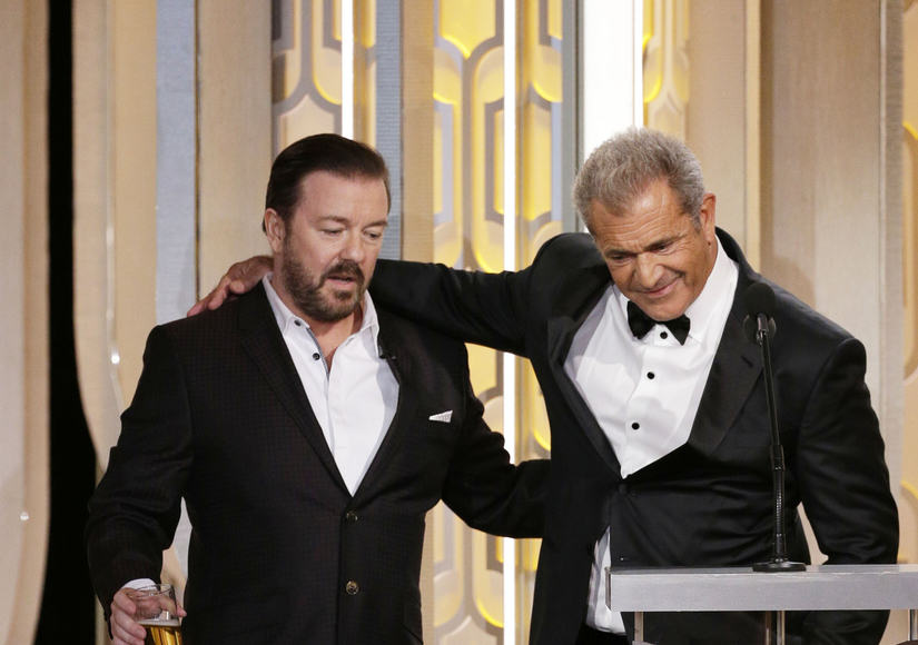 BEVERLY HILLS, CA - JANUARY 10: In this handout photo provided by NBCUniversal, Host Ricky Gervais and presenter Mel Gibson speak onstage during the 73rd Annual Golden Globe Awards at The Beverly Hilton Hotel on January 10, 2016 in Beverly Hills, California. (Photo by Paul Drinkwater/NBCUniversal via Getty Images)