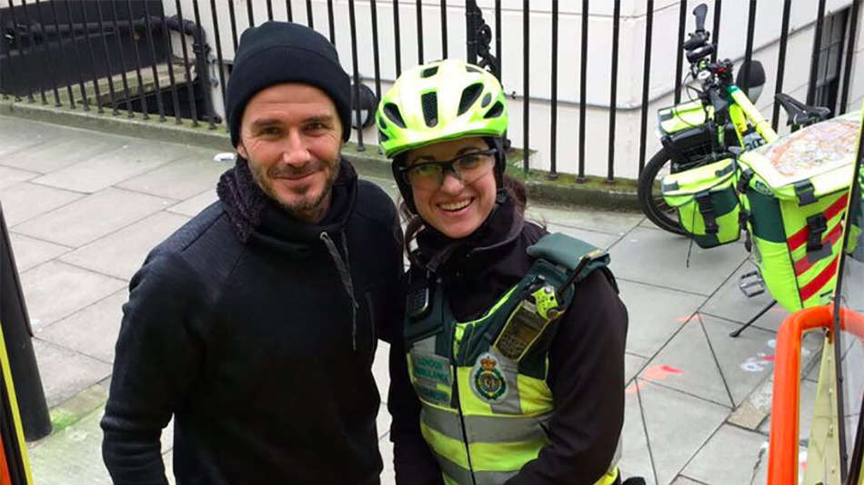 David Beckham Stops To Help Paramedic With Injured Elderly Man David Beckham helping paramedic