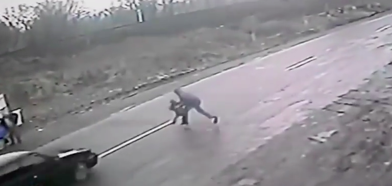 Dramatic Footage Shows Hero Dad Save Son From Speeding Car Screen Shot 2016 02 24 at 13.07.17