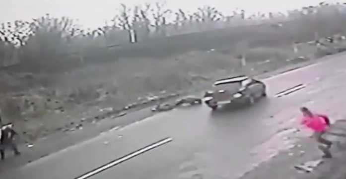 Dramatic Footage Shows Hero Dad Save Son From Speeding Car Screen Shot 2016 02 24 at 13.07.50
