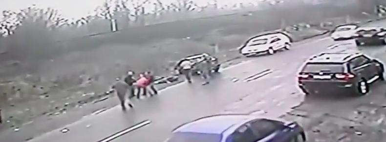 Dramatic Footage Shows Hero Dad Save Son From Speeding Car Screen Shot 2016 02 24 at 13.08.20