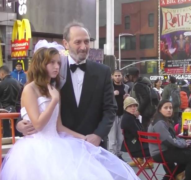 People React To Pensioner Showing Off His Child Bride In Times Square bride2