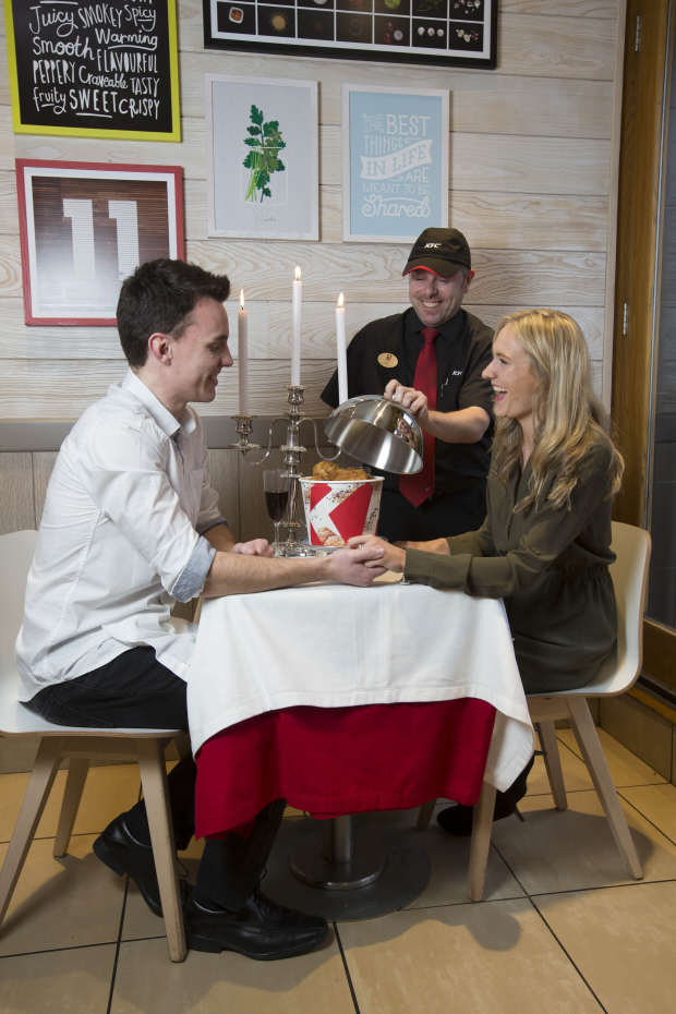 KFC Are Trying Out Romantic Table Service For Valentines Day regional general manager gary mather presents the kfc bargain bucket better than any bouquet this valentinec3b4c3a7c3b6s day