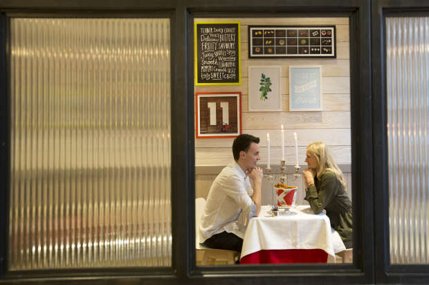 KFC Are Trying Out Romantic Table Service For Valentines Day the couple enjoy the colonels hospitality as they sit deep in conversation at the date night table in kfc