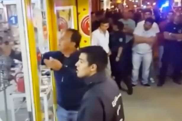 Video Shows Dramatic Moment Thief Takes Woman Hostage At Knifepoint A robber who was caught in the act by police grabbed on to a nearby woman