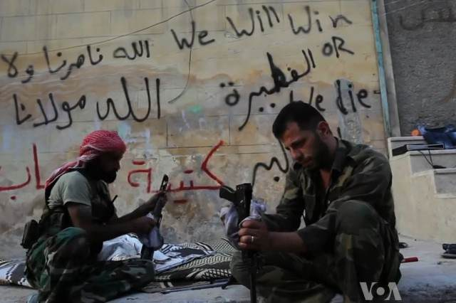 The CIA Have Accidentally Been Fighting The Pentagon In Syria FSA rebels cleaning their AK47s 640x426