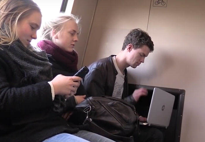 Prankster Watches Incredibly Loud Porn On Train To See How People React train2