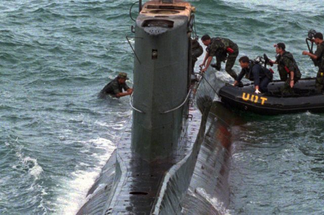 South Korean soldiers inspect a North Korean submarine in 1996