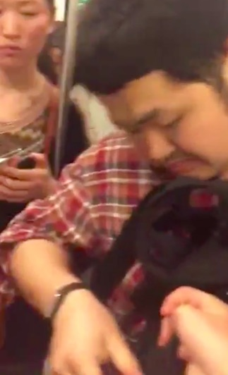 Guy Caught With Upskirt Camera On Train Forced To Eat His SD Card train3