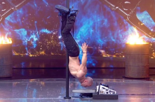 Viewers Furious After Spotting Safety Wire During Life Threatening Britains Got Talent Stunt Alex Magala vaults on the judges table in dare devil LIVE chainsaw act which leaves audiences gasping