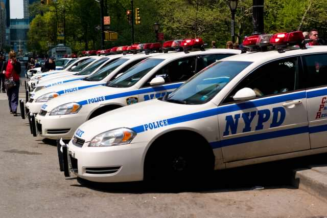 Cop Suspended After Brutal Video Shows Him Threatening Onlookers With Gun NYPD cars line up 640x426