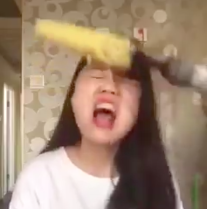 Woman Tries To Eat Corn From Power Drill, Rips Hair Out Screen Shot 2016 05 09 at 09.04.57