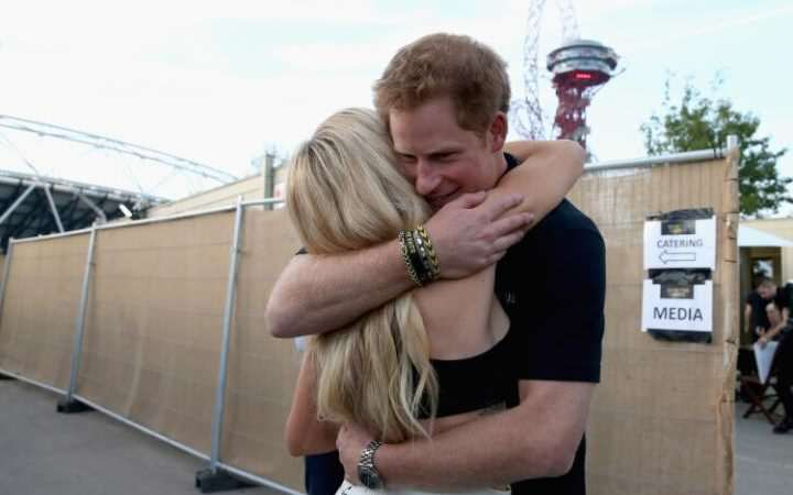 Prince Harry May Have A Secret Celebrity Girlfriend 100078982 LONDON ENGLAND   SEPTEMBER 14  Prince Harry hugs Ellie Goulding backstage at the Invictus large transGO3nPzUHtl7QIt9kBJy kuprYwTgBm4iwmGV00CEQc