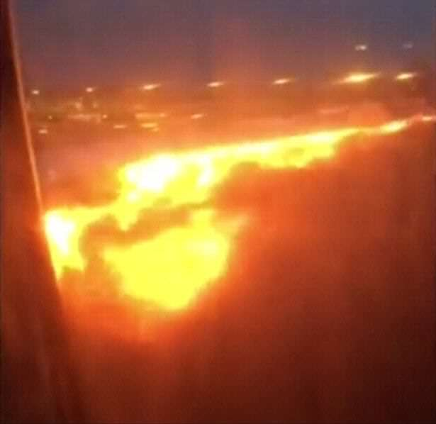Fire-burns-on-the-right-wing-of-a-Singapore-Airlines