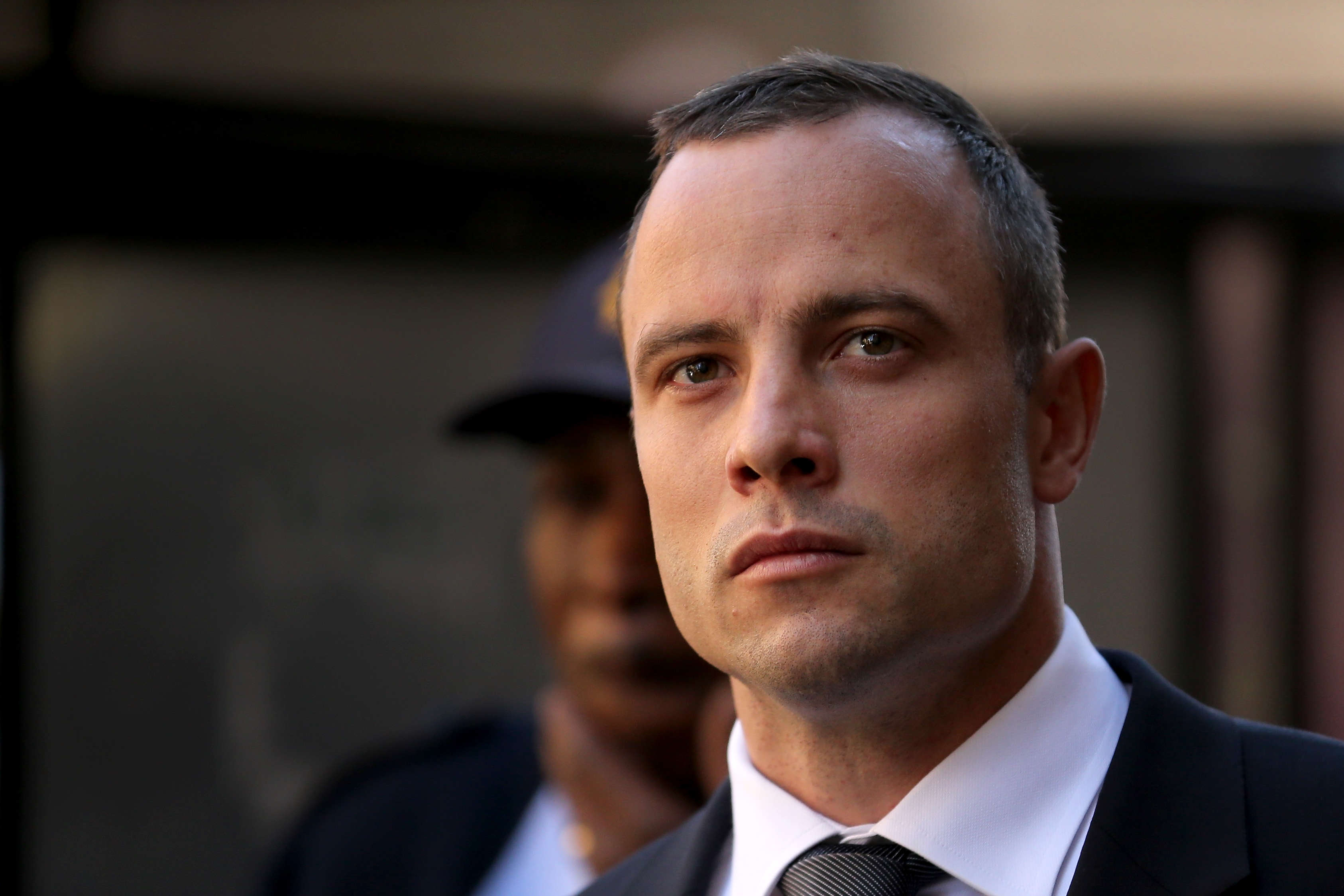 Oscar Pistorius Shocks Court By Walking On His Stumps GettyImages 490302359