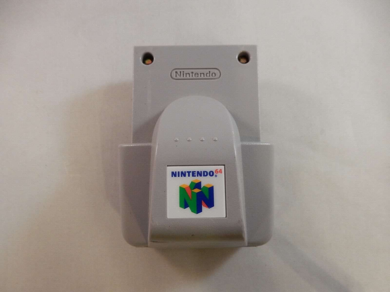 official-genuine-oem-nintendo-64-n64-rumble-pak-nus-013-tested-a238-e1277402706cef45d676ca8def9e0fa9