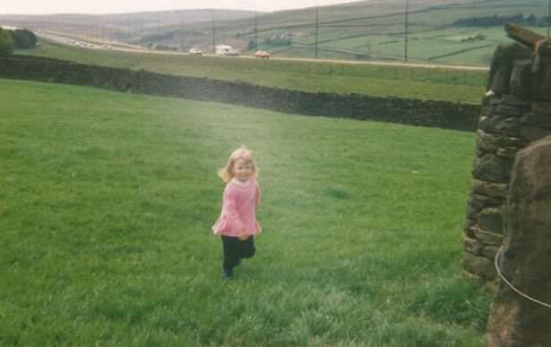 Woman Reveals What Growing Up In House In Middle Of M62 Was Like Kimberley as a child with the motorway behind her