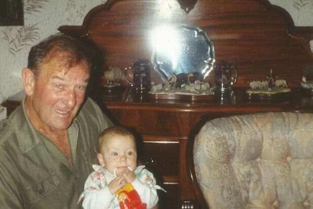 Woman Reveals What Growing Up In House In Middle Of M62 Was Like Kimberley with her granddad Ken in the living room at Stott Hall Farm