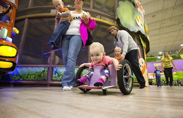 Parents Build Awesome Homemade Wheelchair For Paralysed Daughter 371C7CF000000578 3744173 Nothing can stop her 13 month old Evelyn Moore has been zipping  a 18 1471387290292