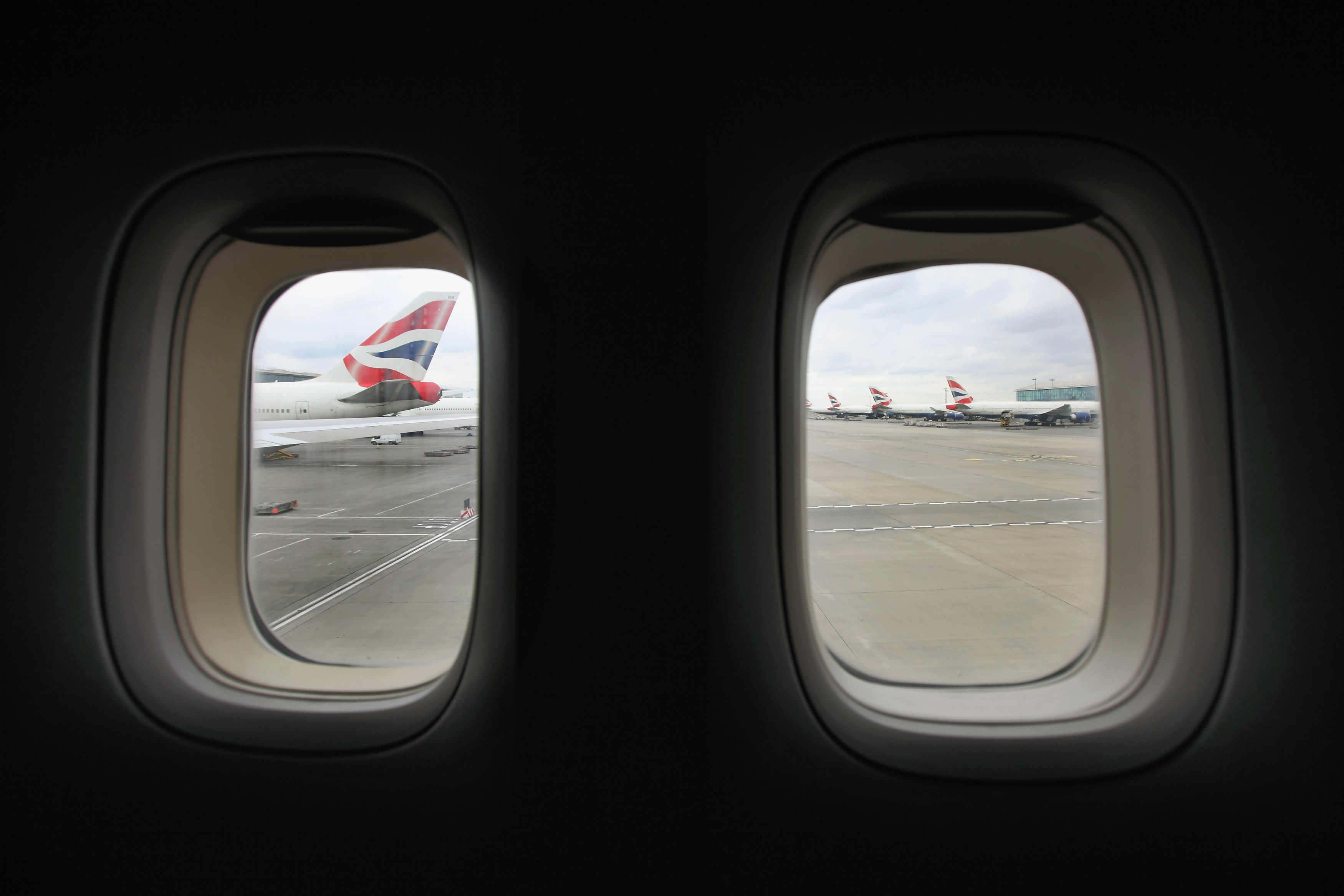 Heres What The Tiny Holes In Airplane Windows Are For GettyImages 139504011