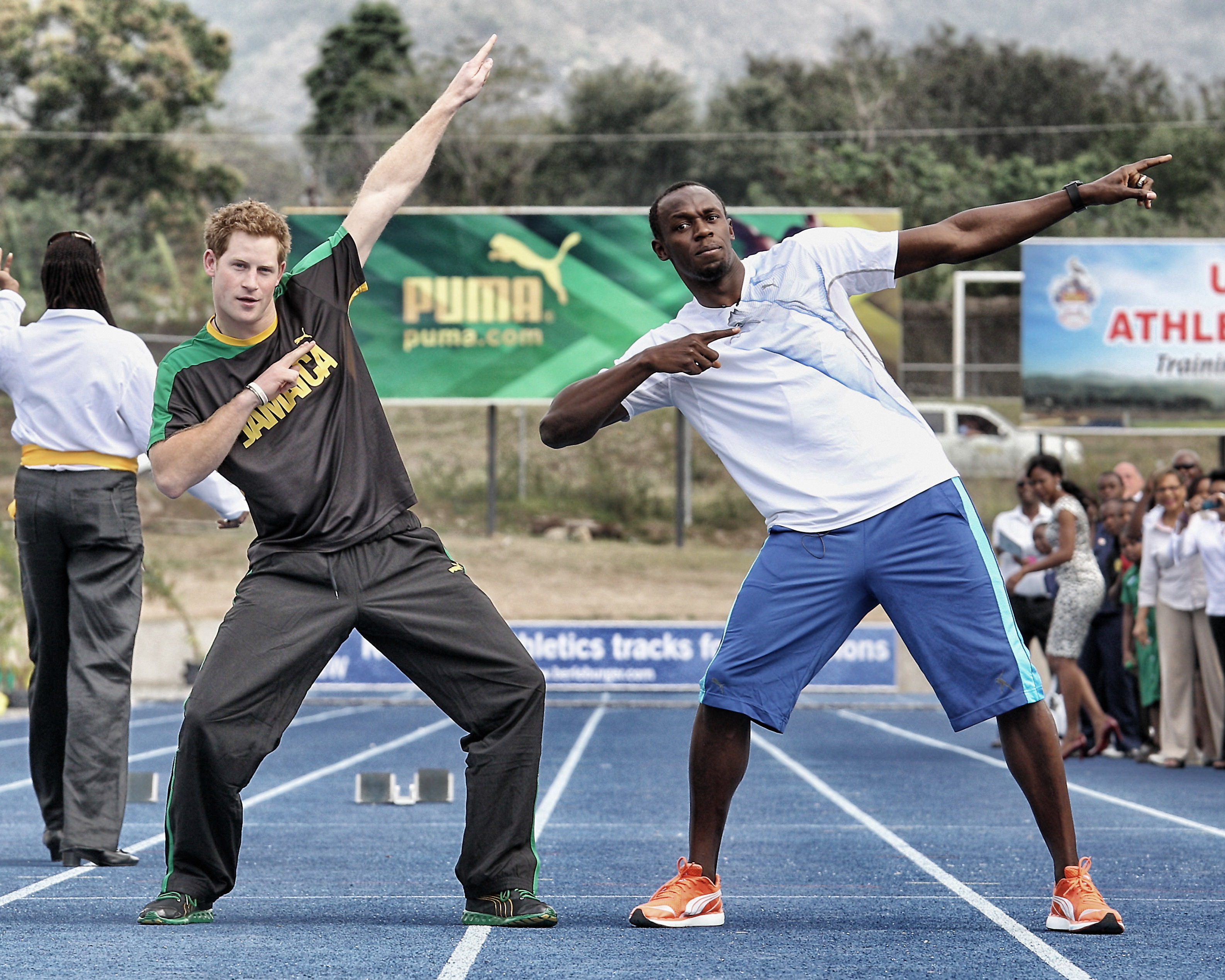 Usain Bolt and Prince Harry doing the lightning bolt