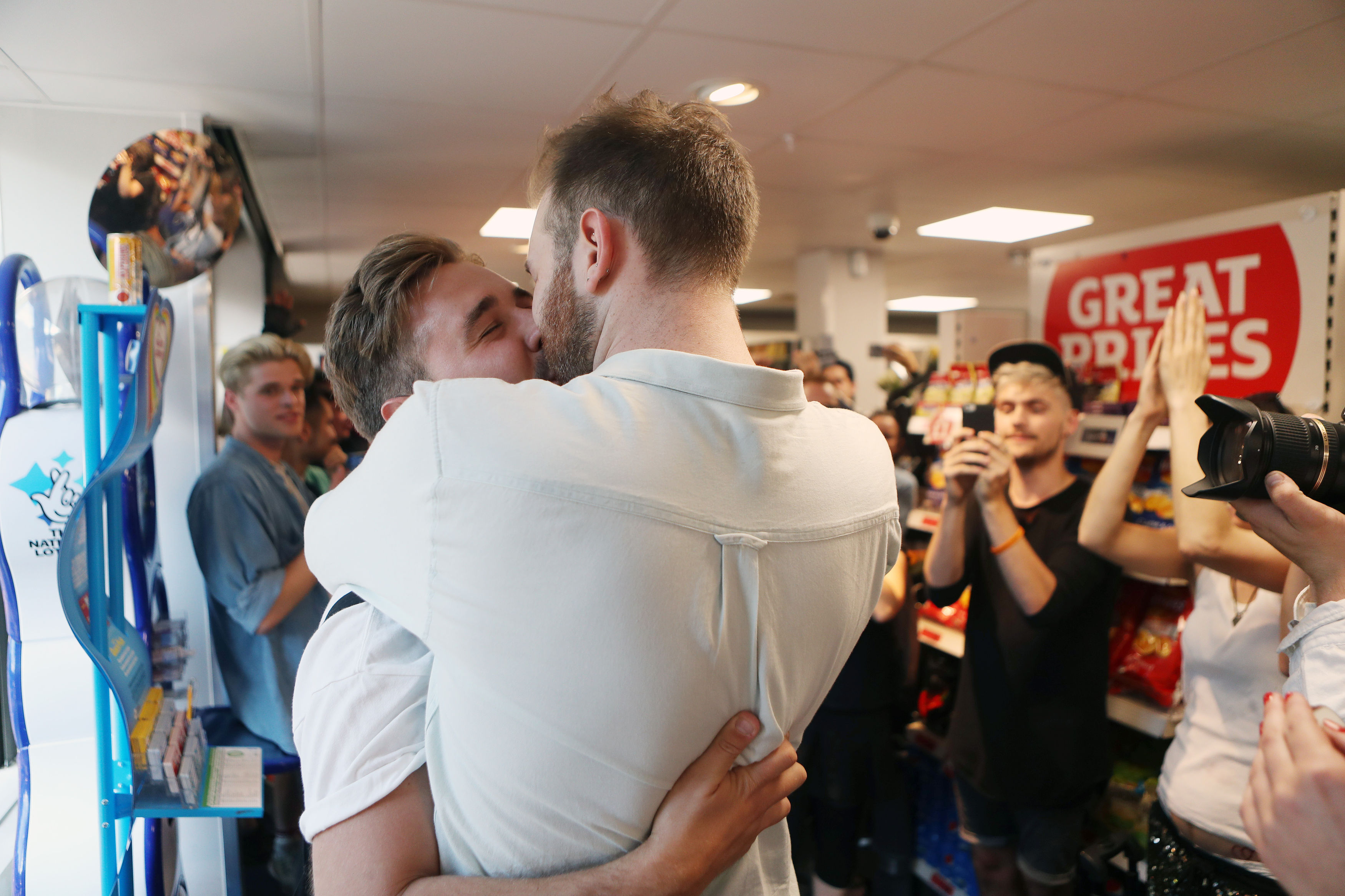 Hundreds Stage Kiss In Protest After Gay Couple Kicked Out Of Sainsbury's PA 28351447