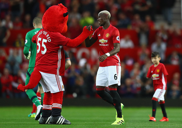 Paul Pogba And Eric Baillys Bromance Is Life Goals Pogba with mascot Getty