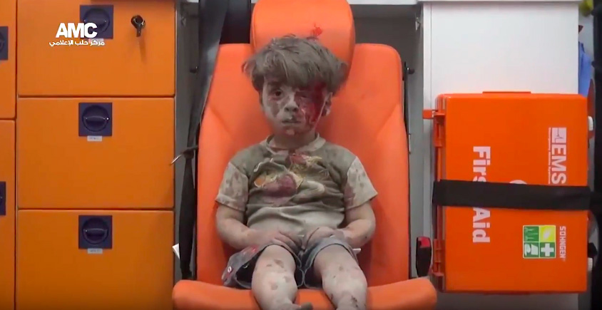 This Child Pulled From Syrias Rubble Is The Shocking Reality Of War Screen Shot 2016 08 18 at 09.23.43