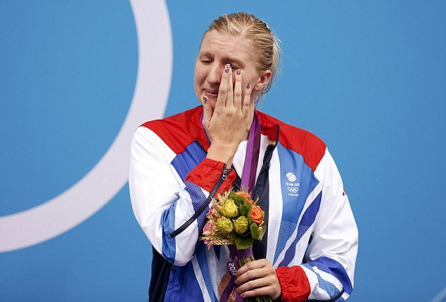 Bronze medallist Britain's Rebecca Adlington wipes away tears at the women's 800m freestyle victory ceremony during the London 2012 Olympic Games at the Aquatics Centre