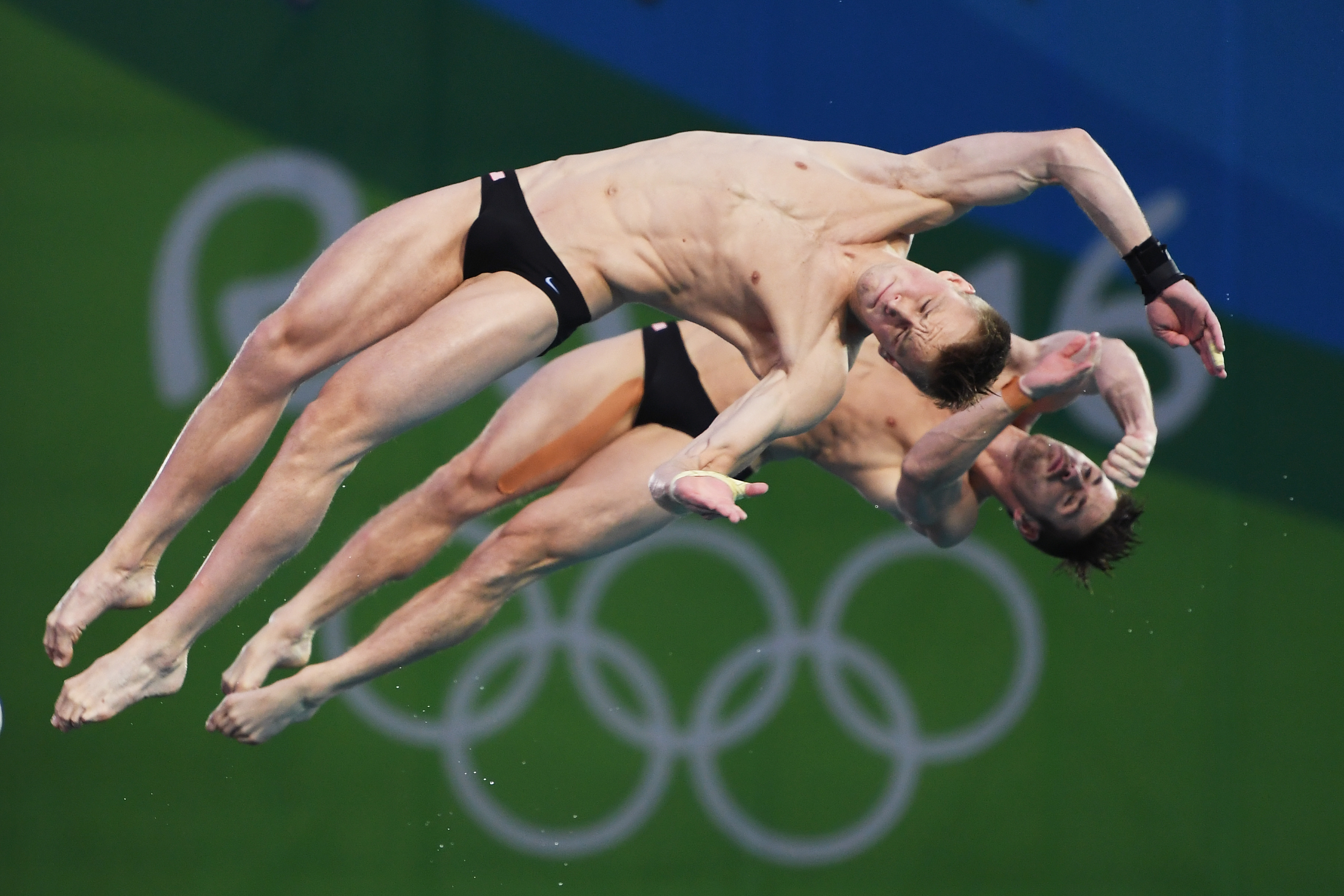 Organisers Finally Reveal Why The Olympic Swimming Pool Turned Green diving1
