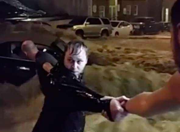 Watch Incredible Moment Human Chain Saves Woman From Flood flood3