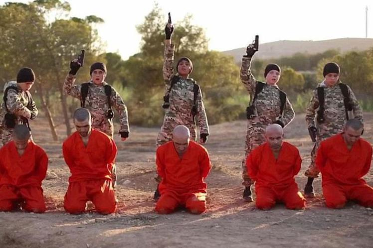 Fathers Horror After Spotting British Son Executing Prisoner In ISIS Video isisvid 2