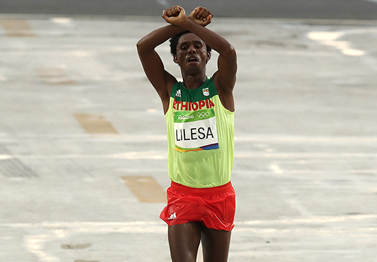 Why This Ethiopian Olympian's Hand Gesture May Get Him Killed