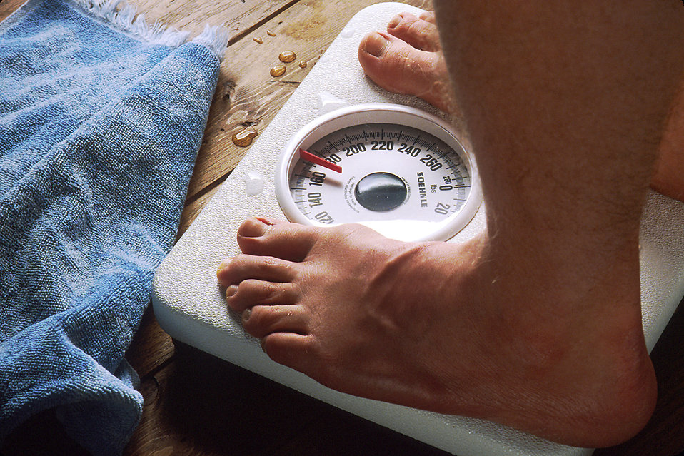 Here Are The Most Common Mistakes People Make Trying To Lose Weight 17079 close up of feet standing on a scale pv