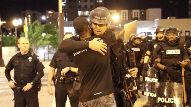 Man Hugs Police Officers During Riot In Powerful Video Screen Shot 2016 09 22 at 11.08.53 PM 620x348