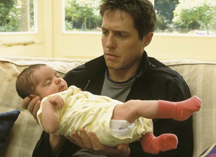 Parents Reveal Why They Regret Having Children hugh grant holding baby awkwardly e1441902735123